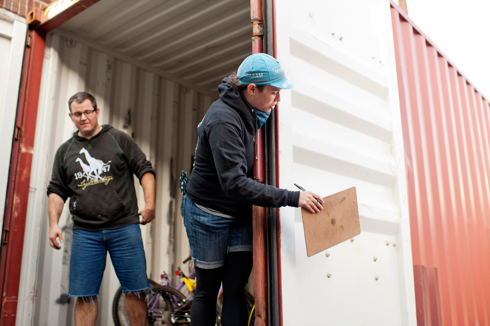 volunteers loading container with used bikes for Bikes Not Bombs in Boston