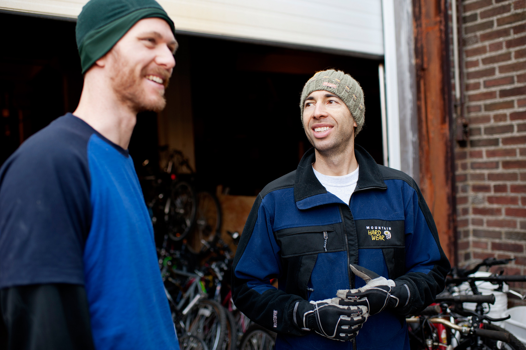 volunteers loading used donated bicycles onto shipping container to ship worldwide for social change