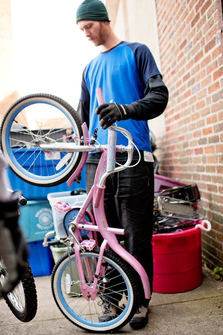 volunteer repairing donated bicycle for Bikes Not Bombs to ship to Guatemala