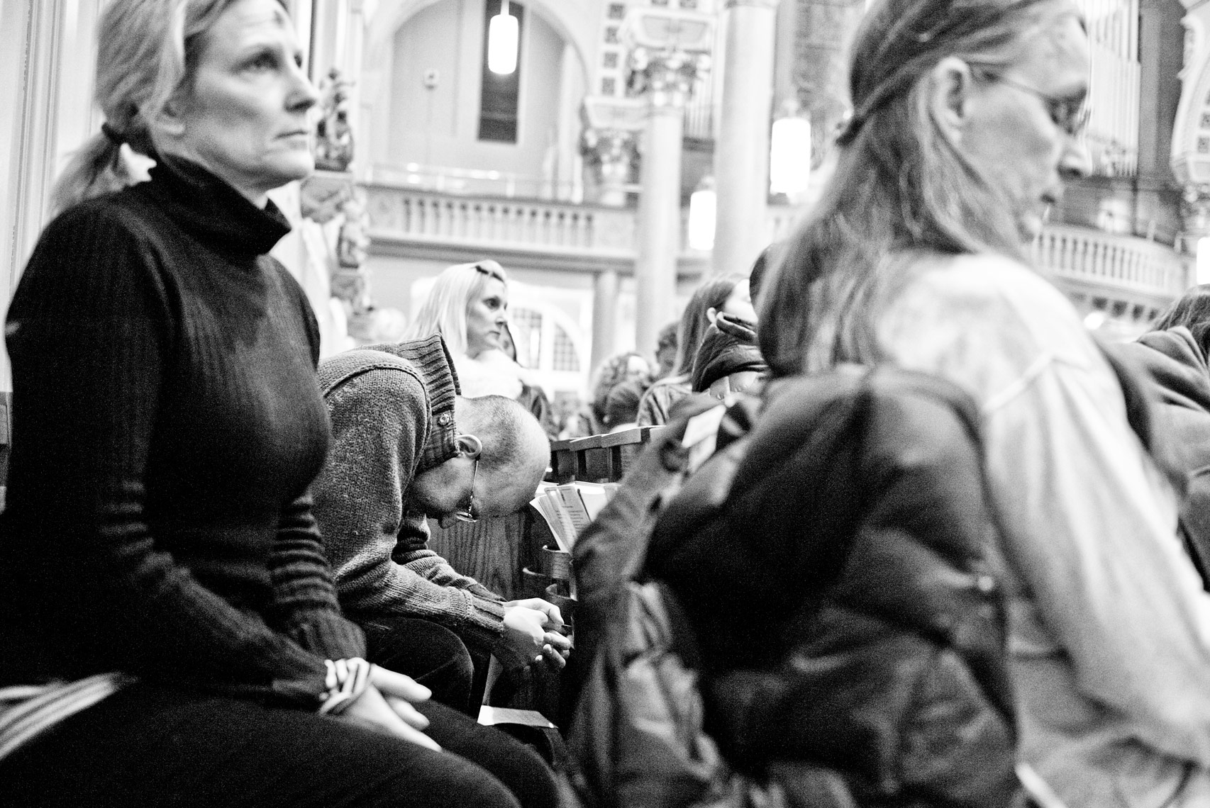 man praying in St. Cecilia Parish Boston on Ash Wednesday