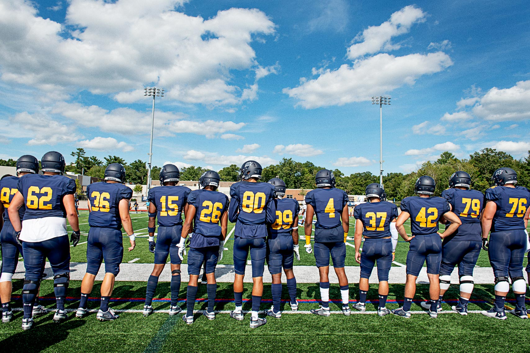 on the sidelines at at college football game Merrimack College Massachusetts