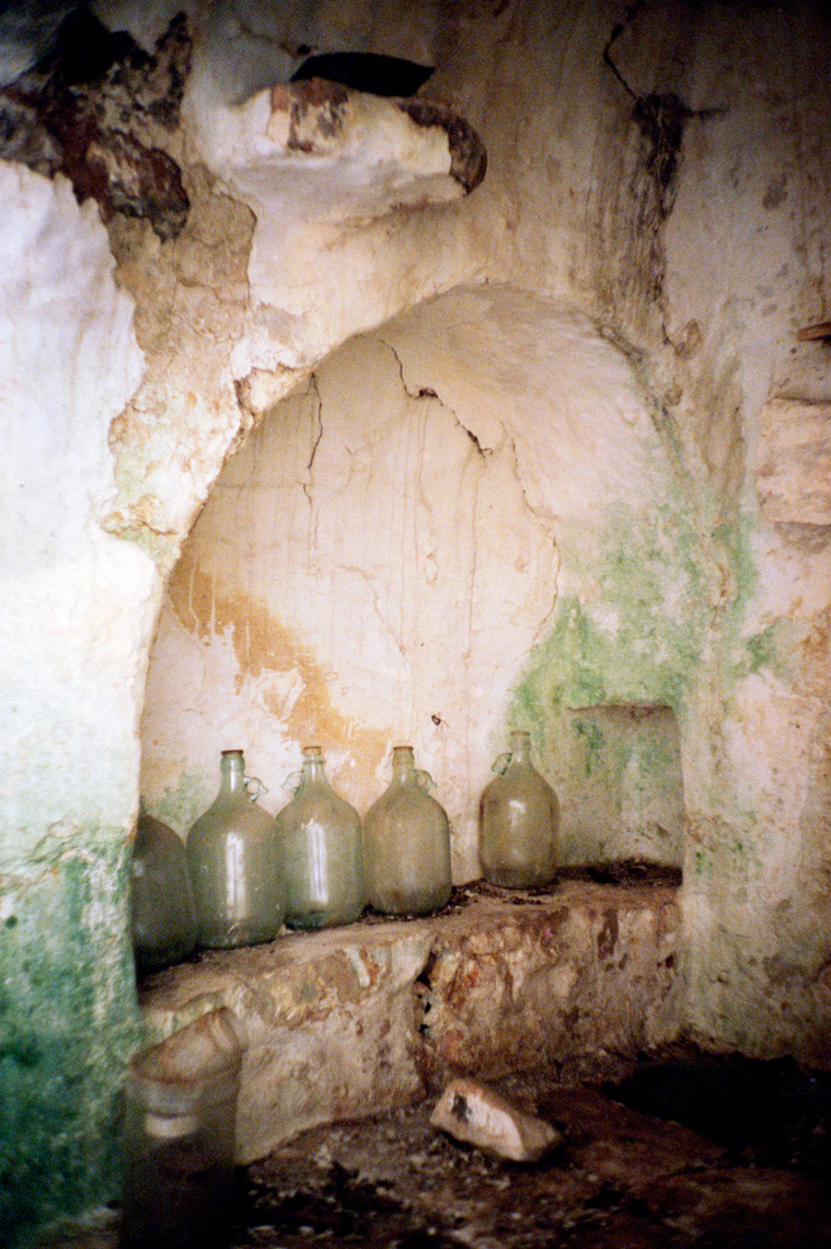 glass wine jugs in trullo traditional Apulia dry stone hut Southern Italy