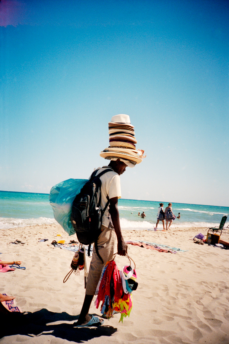 hat vendor on beach Torre Canne, Puglia, Webb Chappell travel photography