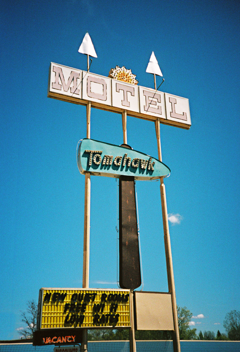 Southwest documentary photograph of motel sign by Webb Chappell