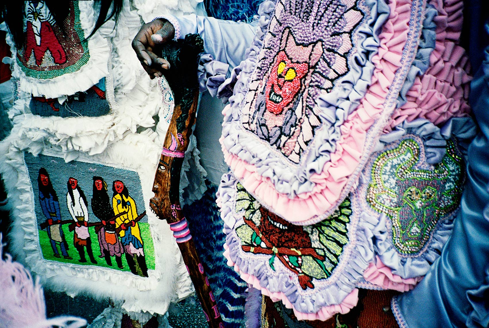 close up of handmade beadwork on costume Mardi Gras Indian for Super Sunday Parade New Orleans