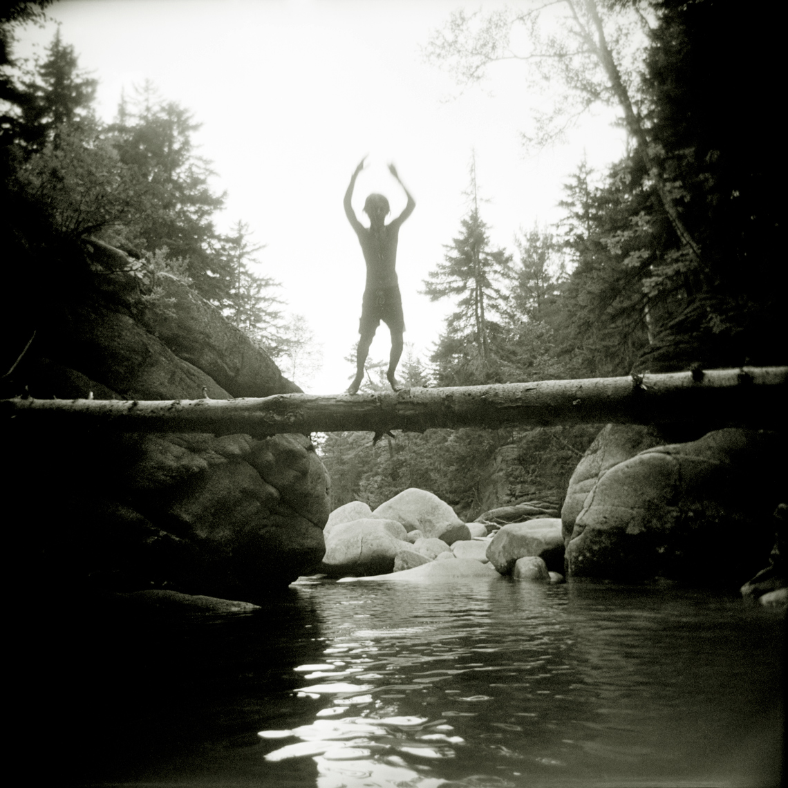 boy swimming in swim hole along Swift River New Hampshire